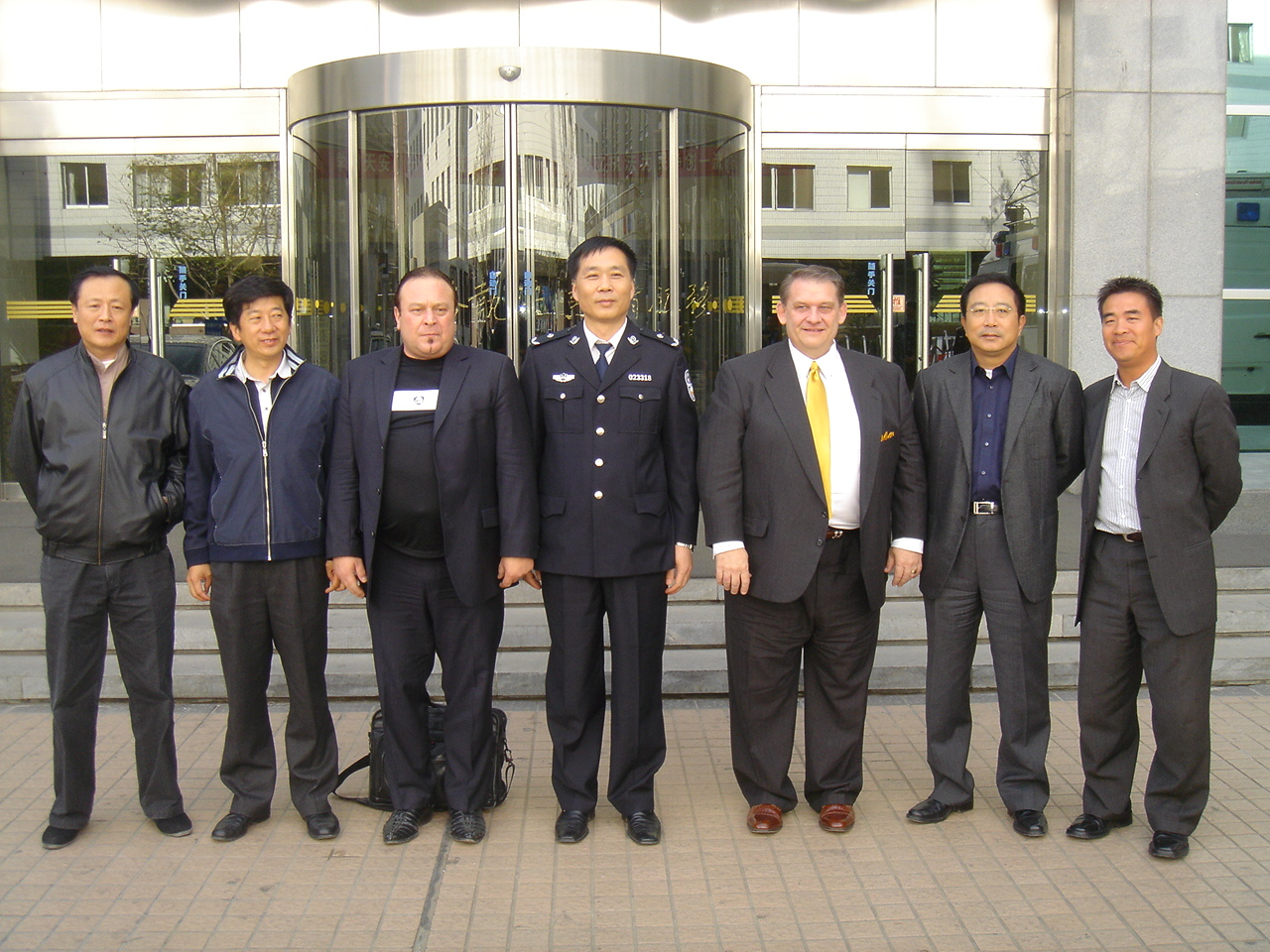 Steve Greschner (third from left), David Hendershott (third from right) and Gang Chen (right) during a tour of the Beijing Security Bureau in fall 2006.(Image courtesy Steve Greschner)